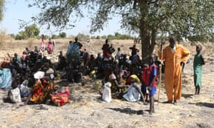 People wait for aid to be distributed in Leer where an estimated 30,000 turned up to receive food.