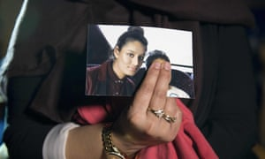 Renu Begum, eldest sister of Shamima, holds a picture of her sister.