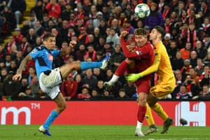 Liverpool's Roberto Firmino hooks the ball goalwards after Napoli's goalkeeper Alex Meret makes a mess of a cross.