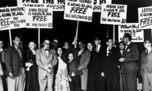 The Hollywood Ten stage a demonstration at Los Angeles airport on their way to prison.