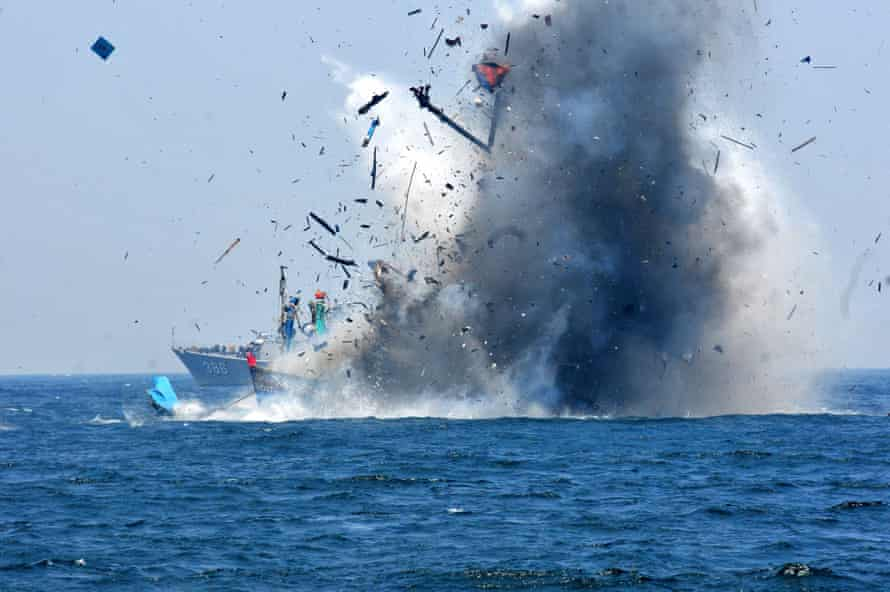 The Indonesian navy blows up a foreign vessel caught fishing illegally in Indonesian waters at Lemukutan Island, Kalimantan.