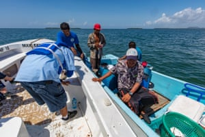 Rangers check the licences of fishers in the Port Honduras Marine Reserve