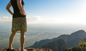 Woman looks over mountain