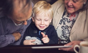 Happy child and Grandparents using a tablet<br>Happy smiling little boy using a tablet with his Grandma and Grandpa