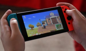 Person playing Animal Crossing on a Nintendo Switch