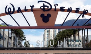A combo picture shows the entrances of the Walt Disney Company (up) and the 21st Century Fox studios in Burbank and Los Angeles, California