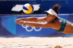 Mariafe Artacho del Solar of team Australia dives to return the ball against team Cuba during the women's preliminary beach volleyball
