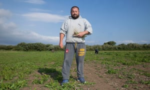 A Polish worker who was furloughed from his job and now helps with the asparagus harvest on David Hartnoll's farm in the village of Braunton, Devon.