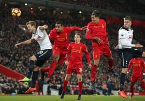 Tottenham Hotspur's Harry Kane, left, and Liverpool's Joel Matip go up for a header.