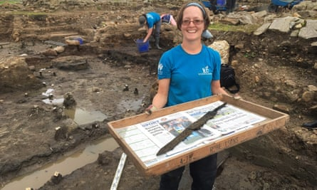Dig volunteer Sarah Baker with one of the rare cavalry swords.