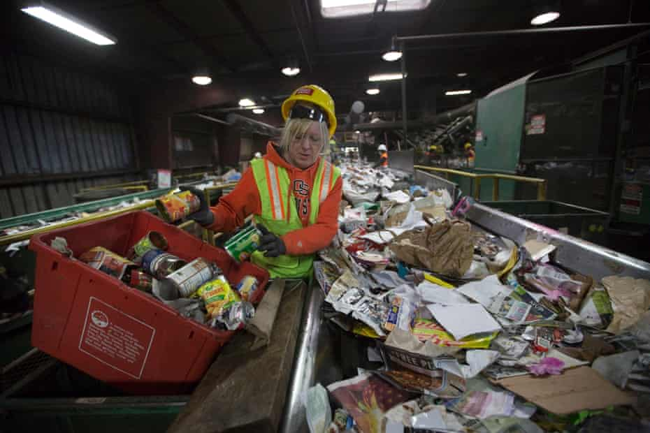 Workers sort paper and plastic waste at in Hillsboro, Oregon, in 2017 – the year China changed its recycling policies.