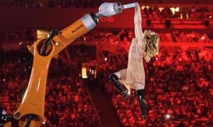 American Paralympic snowboarder Amy Purdy dances with a robot during the opening ceremony of the Rio 2016 Paralympic Games.
