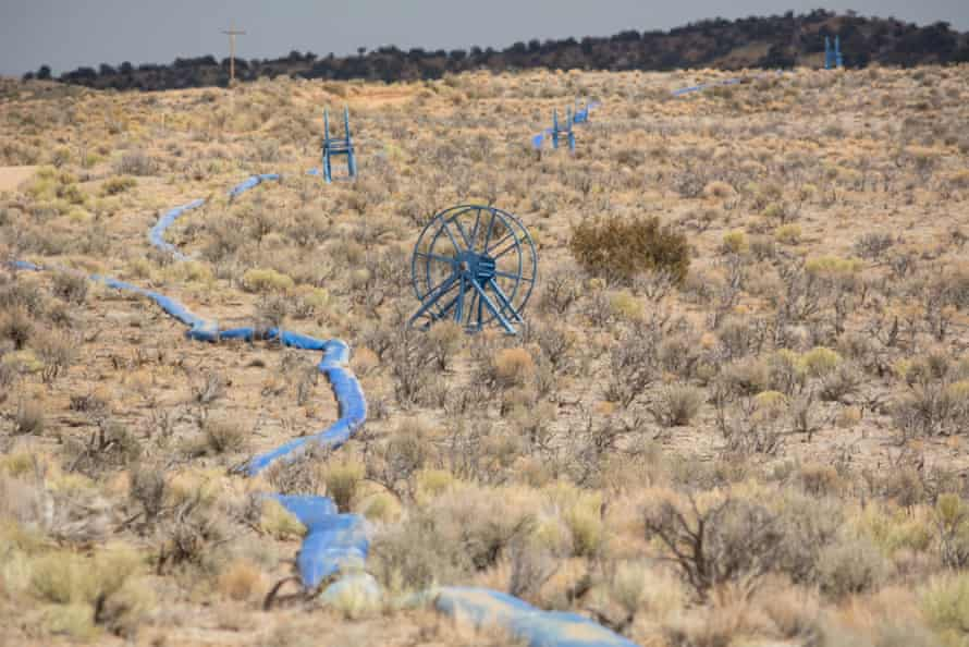 A fracking water hose runs through the desert and connects with a fracking operation on Navajo trust land north of Chaco Culture national park.