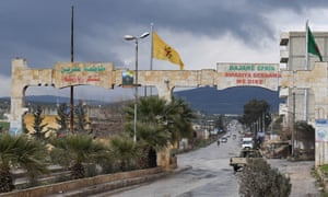 A YPG flag flying near an entrance to the city of Afrin.