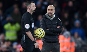 Pep Guardiola stares at referee Michael Oliver as he walks onto the pitch for the second half