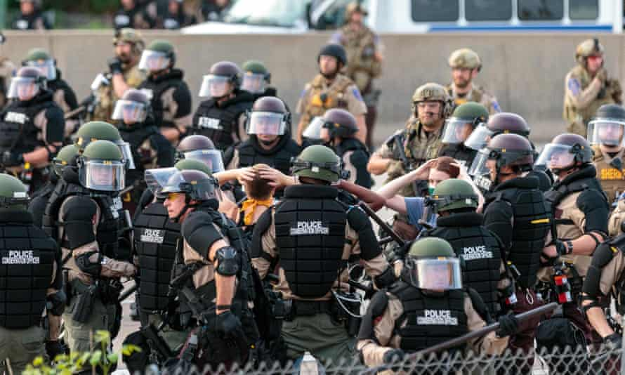 Police surround protesters in Minneapolis.