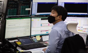 A South Korean dealer works in front of monitors at the Kookmin Bank (KB) in Seoul, South Korea, 4 May 2020, during.