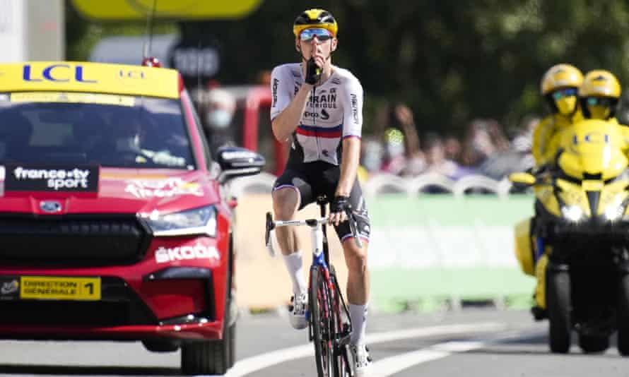 Slovenia's Matej Mohoric gestures as he crosses the finish line to win stage 19.