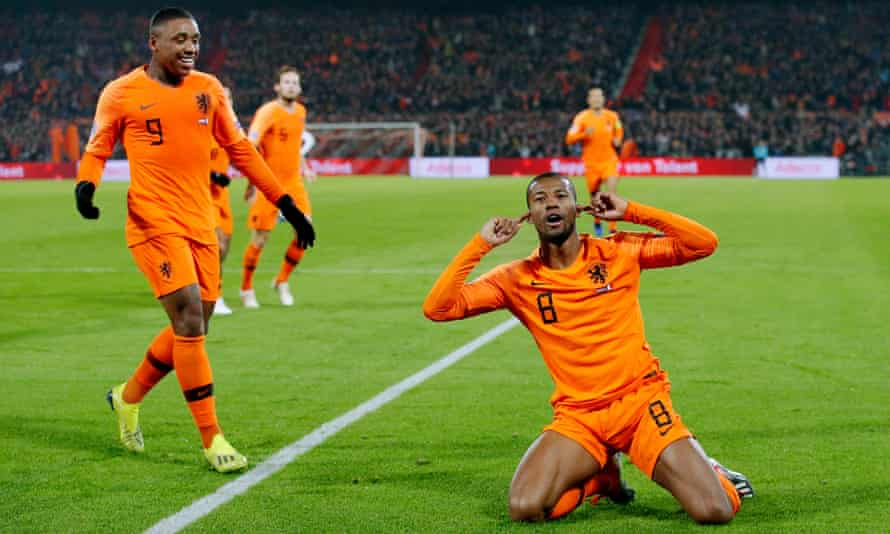 Gini Wijnaldum celebrates after opening the scoring in the closing minutes of the first half.