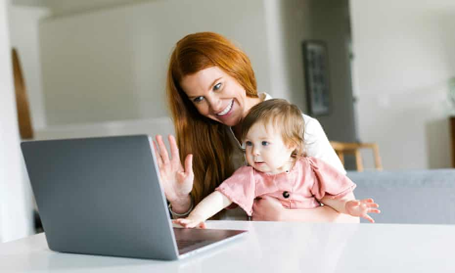 Mother and daughter using laptop to video chat (posed by models)