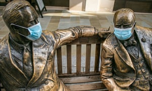 A sculpture featuring wartime leaders Winston Churchill and Franklin Roosevelt wearing protective facemasks in London.