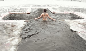 A girl bathes in ice water to celebrate orthodox epiphany