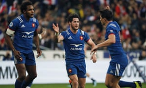 France's scrum-half Maxime Machenaud, centre, is congratulated by Francois Trinh-Duc, right.