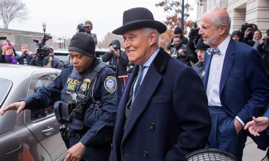 Roger Stone leaves court after the judge sentenced him to 40 months in prison.