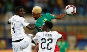 Clinton Njie in action with Ghana's Jonathan Mensah and Andrew Yiadom.