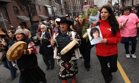 People attend a rally in remembrance of the missing and murdered women and girls in Vancouver in February.