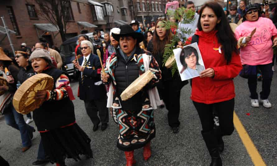 People attend a rally in remembrance of the missing and murdered women and girls in Vancouver last year.