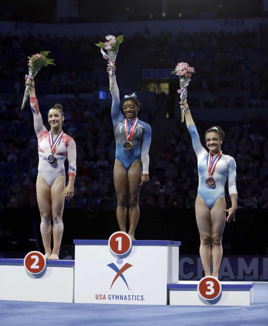 First place finisher Simone Biles, stands on the podium with second place finisher Aly Raisman and third place finisher Lauren Hernandez during the U.S. women's gymnastics championships in St Louis.