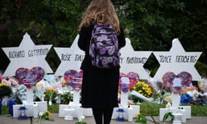 A woman stands at a memorial outside the Tree of Life synagogue after a shooting in Pittsburgh, Pennsylvania on 27 October 2018.