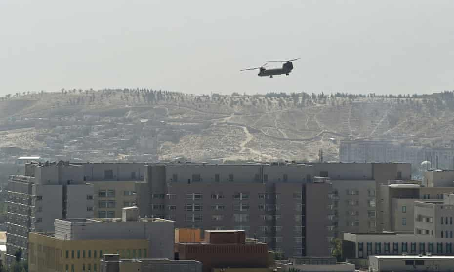 Chinook military helicopter flies above the US embassy in Kabul