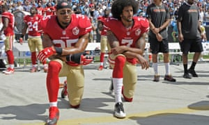 Colin Kaepernick and Eric Reid (left) kneel during the national anthem before a game in 2016