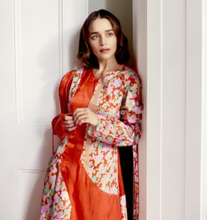 'I help provide relief. And that's worth something': Emilia Clarke wears an orange silk dress by rejinapyo.com