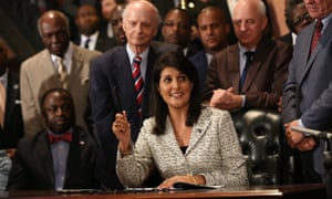 Nikki Haley, then governor of South Carolina, signs into law a bill removing the Confederate flag flying at the state house in Columbia, on 9 July 2015.