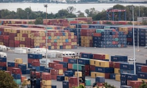 Containers from cargo ships are stacked at a port in Elizabeth, New Jersey., as global supply chain disruptions hit economies