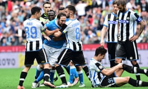 Gonzalo Higuaín has to be held back after receiving a red card during his Napoli side's 3-1 defeat at Udinese