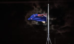 The national flag of New Zealand is flown at half-mast on a Parliament building after the shooting incident in Christchurch