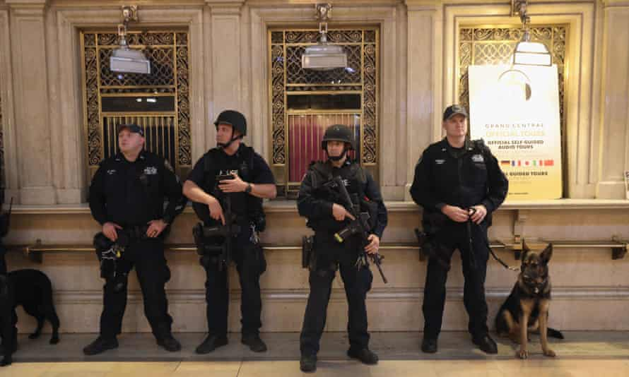 New York City policemen stand guard in Grand Central Terminal on Wednesday in New York City.
