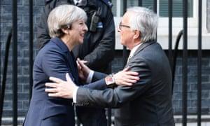 Theresa May greeting EC president Jean-Claude Juncker