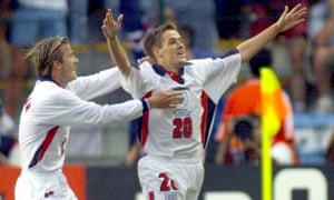 England's Michael Owen (right) celebrates his goal with teammate David Beckham .