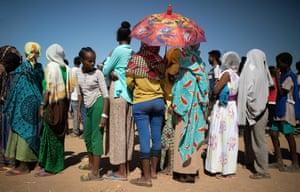 Refugees queue for food distribution in Um Rakuba refugee settlement in Eastern Sudan.