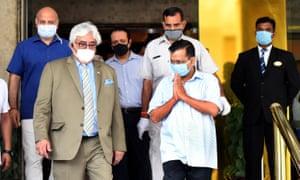 Delhi's chief minister, Arvind Kejriwal, visits the Suryaa hotel.