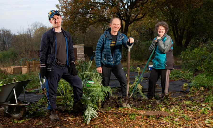 Steve Lewis, centre, with his son, James, and wife, Annette, on their allotment in Sheffield.