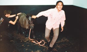 Princess Shamsa in a stables with a horse.