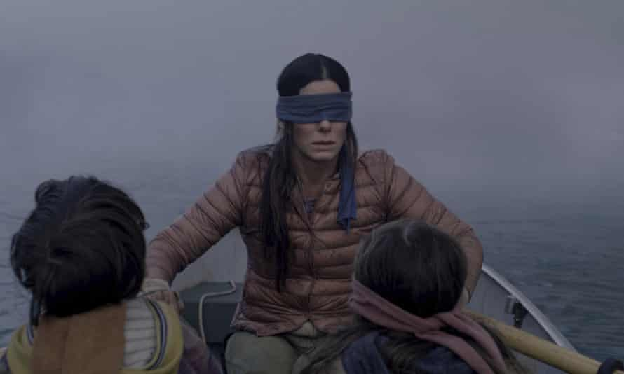 """FILE- This file image released by Netflix shows Sandra Bullock in a scene from the film, """"Bird Box."""" Netflix lifted the usually tightly sealed lid on its viewership numbers in a recent tweet that disclosed 45 million subscriber accounts had watched the thriller, """"Bird Box,"""" during its first seven days on the service. That made the film the biggest first-week success of any movie made so far for Netflix's 12-year-old streaming service. (Merrick Morton/Netflix via AP, File)"""