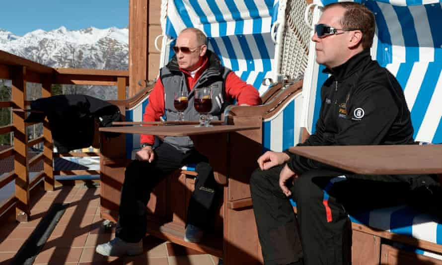 Medvedev (right) and Putin drinking tea in a skiing and biathlon complex at Krasnaya Polyana mountain resort in southern Russia in 2014.