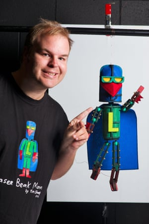 Sharp with the puppet version of his character, Laser Beak Man.